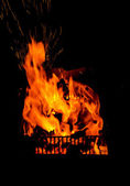 Fire in fireplace black background — Stock Photo