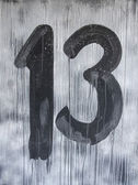 Sign with number 13 in friday night — Stock Photo