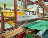 Weaving loom and shuttle on the warp — Stock Photo