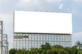 Blank billboard ready for new advertisement and blue sky — Foto Stock