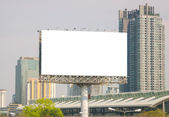 Large blank billboard with city view background — Stock Photo