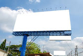 Blank billboard ready for new advertisement and blue sky — Stock Photo