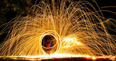 Fire dancing show amazing at night — Stock Photo