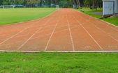 Running track in stadium — Stock Photo