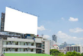 Large blank billboard on road with city view background — ストック写真
