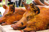 Grilled whole roasted pig Spit roasting is a traditional — Stock Photo