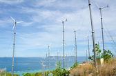Wind turbine generating electricity on hill — Foto Stock