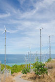 Wind turbine generating electricity on hill — Stockfoto