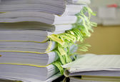 Pile of documents on desk stack up high waiting to be managed. — Stock Photo