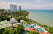 Top view of Swimming pools at tropical beach in luxury hotel — Stok fotoğraf
