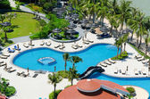 Top view of Swimming pools at tropical beach in luxury hotel — Stockfoto