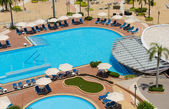Top view of Swimming pools at tropical beach in luxury hotel — Stock Photo