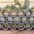 Stacked concrete drainage pipes — Stock Photo #50442489