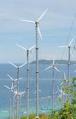 Wind turbine generating electricity on hill — Stock Photo