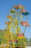 Ferris wheel and blue sky — Stock Photo