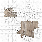 White Puzzle with Wooden Background — Stock Photo