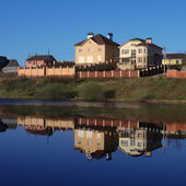 House on the river — Stock Photo