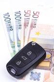 Car key on the money — Stock Photo