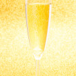 Stock Photo: Champagne flute in golden