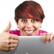 Woman using laptop and doing thumbs up — Stock Photo #27669727
