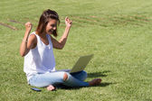 Happy woman using laptop — 图库照片