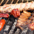 Steak and other Meat on BBQ — Stock Photo