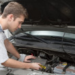 Repairing under car hood — Stock Photo
