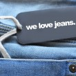 Jeans with tag - Stock Photo
