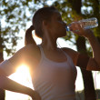 Young woman drinking water during her workout — Stock Photo