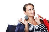 Piękna młoda kobieta z torby na zakupy — Zdjęcie stockowe