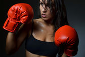 Beautiful woman with the red boxing gloves — Stock Photo
