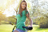 Young woman with bicycle — Stock Photo