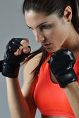 Beautiful fitness woman with the black boxing bandage — Stock Photo