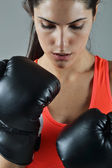 Beautiful fitness woman with the black boxing gloves — Foto Stock