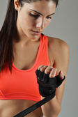 Beautiful fitness woman with the black boxing bandage — Foto Stock