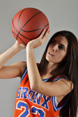Beautiful woman with the basketball, studio shot — Stock Photo