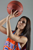 Beautiful woman with the basketball, studio shot — Stock Photo