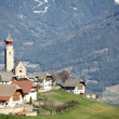 Typical Italian village in South Tyrol with church — Stock Photo