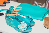 Turquoise sandals and handbag — Stock Photo