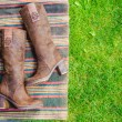 Suede boots women lie on the grass — Stock Photo #51113977