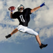 American Football Quarterback gets ready to make pass. - Foto de Stock
