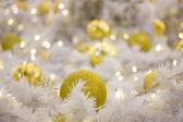 Yellow Christmas bulbs and silver tree — Stock Photo