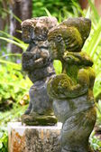 Balinese stone statues — Stock Photo