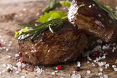 Steak on wood — Stock Photo