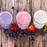 Fresh fruits milk shake on wood — Stock Photo #43222465