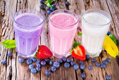 Fresh fruits milk shake on wood — Stockfoto