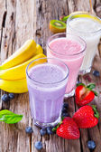 Fresh fruits milk shake on wood — Stock Photo