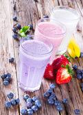 Fresh fruits milk shake on wood — Foto de Stock