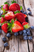 Fresh fruits on wood — Stock Photo