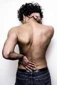 Man with lower pack and neck pain — Stock Photo